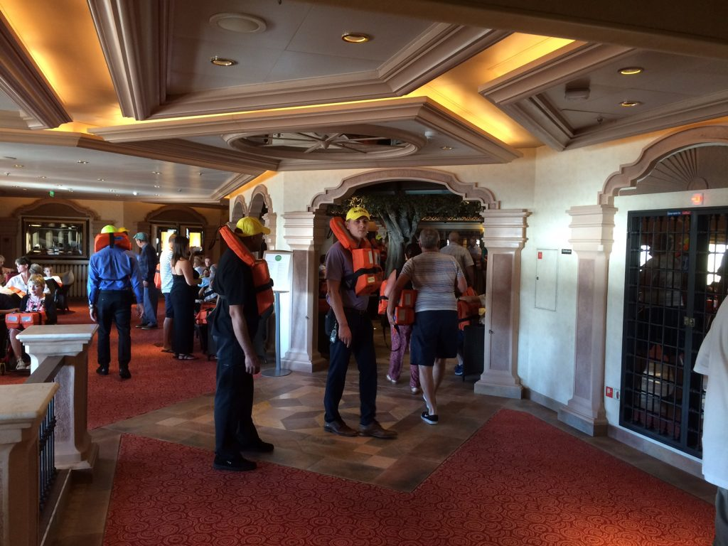 Inside a muster station at passenger emergency drills